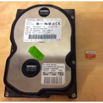 4gb hard drive next to 64gb microsd card
